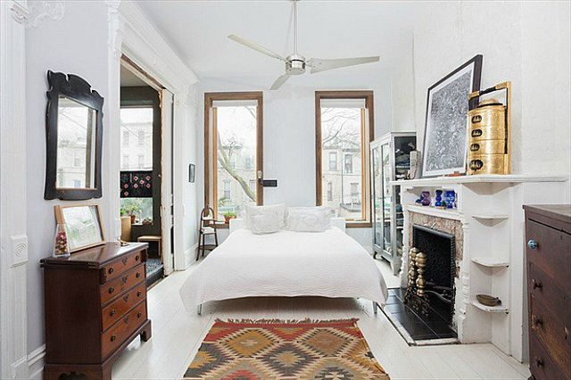 Above the kitchen is the parlor floor, which comes soaked in light and is currently set up as a master bedroom with an artist studio. There's also a walk-in closet...