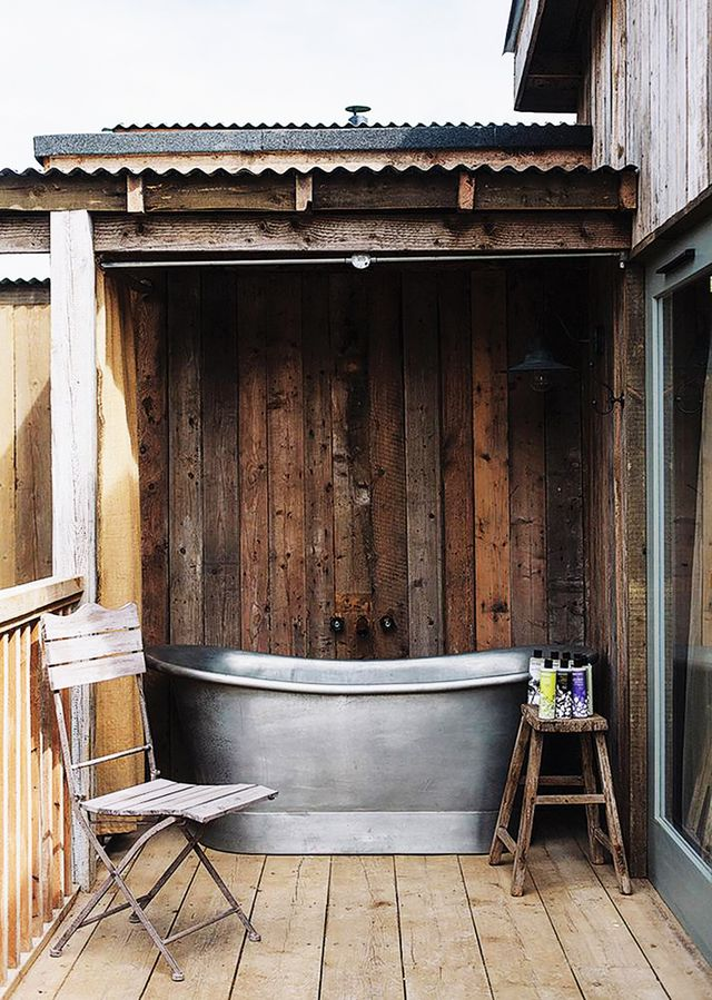 Just outside one of the guest cabins at Soho House's buzz-worthy new English private member's club and country house hotel, Soho Farmhouse, a galvanized steel soaking tub has simple,...