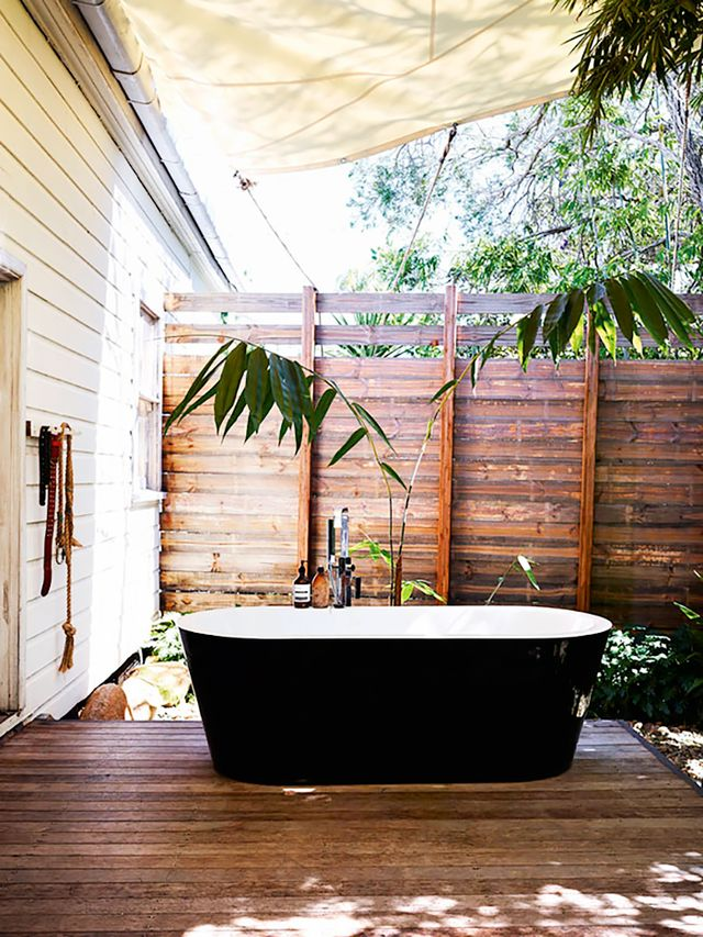 In his Byron Bay home, which we recently featured, Australian artist David Bromley set a contemporary black freestanding bathtub on his back porch. Beneath an awning and surrounded by trees, it...