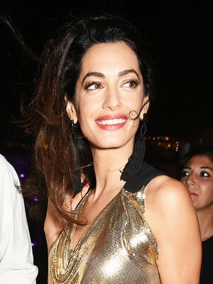 See the Plunging Dress Amal Clooney Wore Out With George