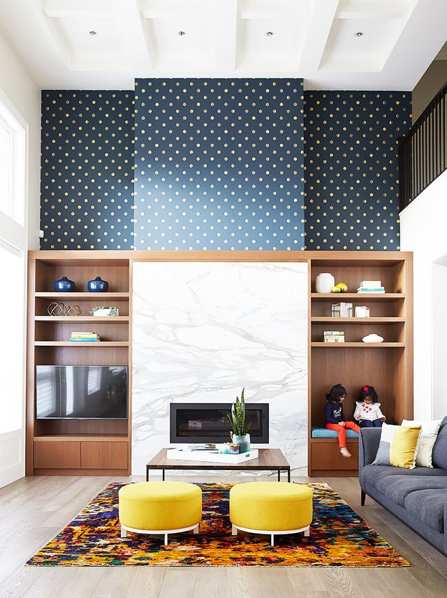 Pattern is the perfect compliment to a large room with high ceilings. The open space can handle bold print, and it willadd a touch of coziness to acold room.