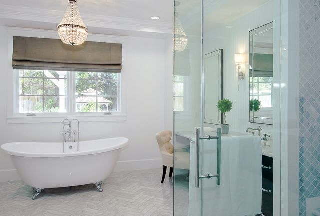 Relaxing should be easy in the master bath's clawfoot bathtub, which is topped by a crystal chandelier.