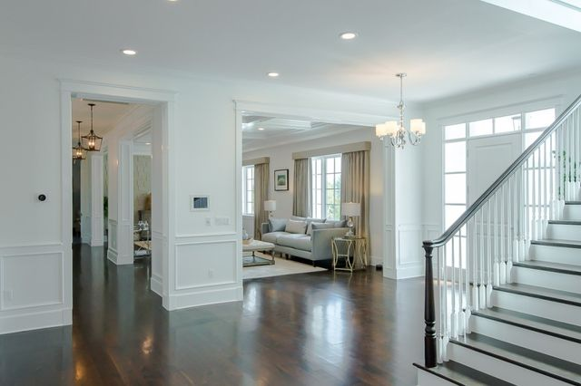 The home's five bedrooms and seven baths include a master suite with a private terrace and an expansive closet.
