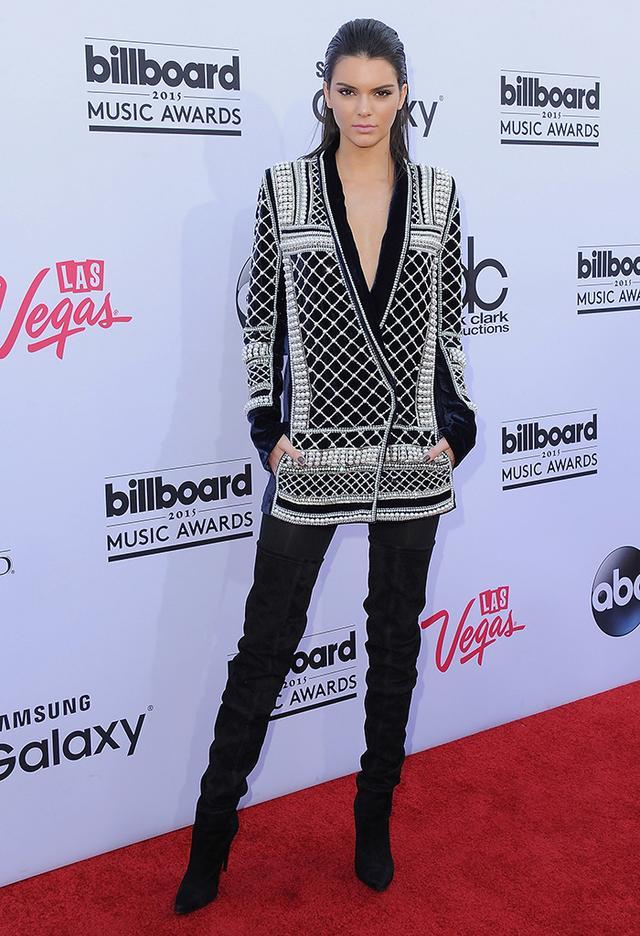 On Jenner: Balmain x H&M dress; Balmain boots.