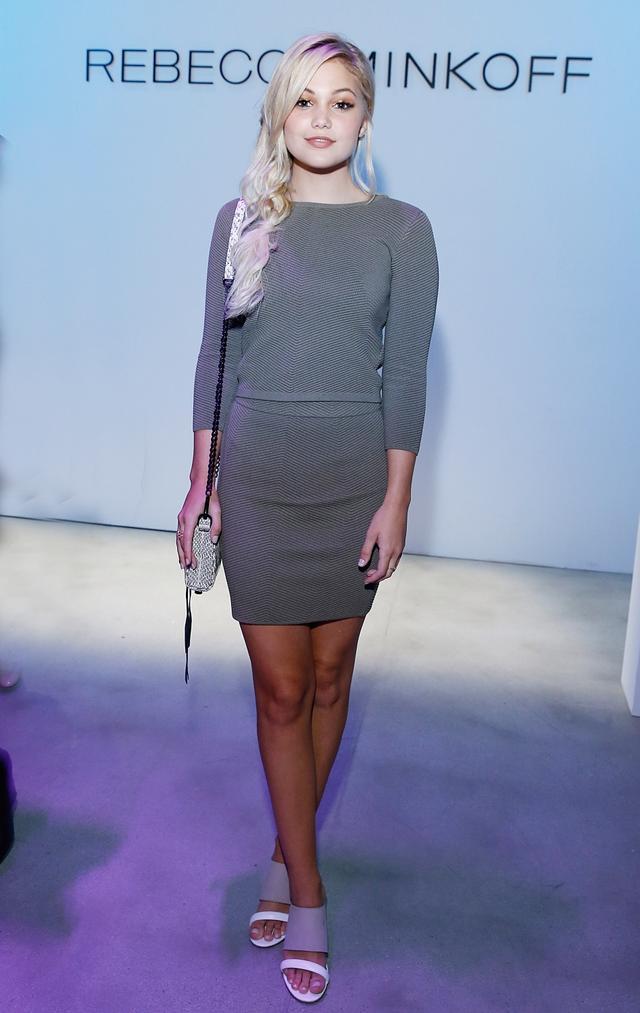 WHO: Olivia Holt  WHAT: Rebecca Minkoff S/S 16 show  WEAR: Rebecca Minkoff sweater, skirt, bag, and heels.