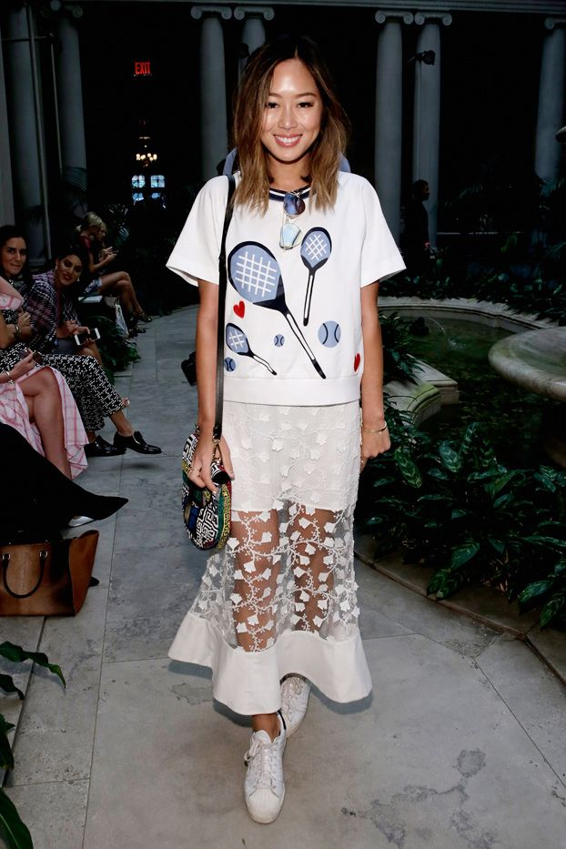WHO: Aimee Song  WHAT: Carolina Herrera S/S 16 show  WEAR: Tommy Hilfiger top; Alice McCall skirt; Versace bag; Adidas x Pharell sneakers.