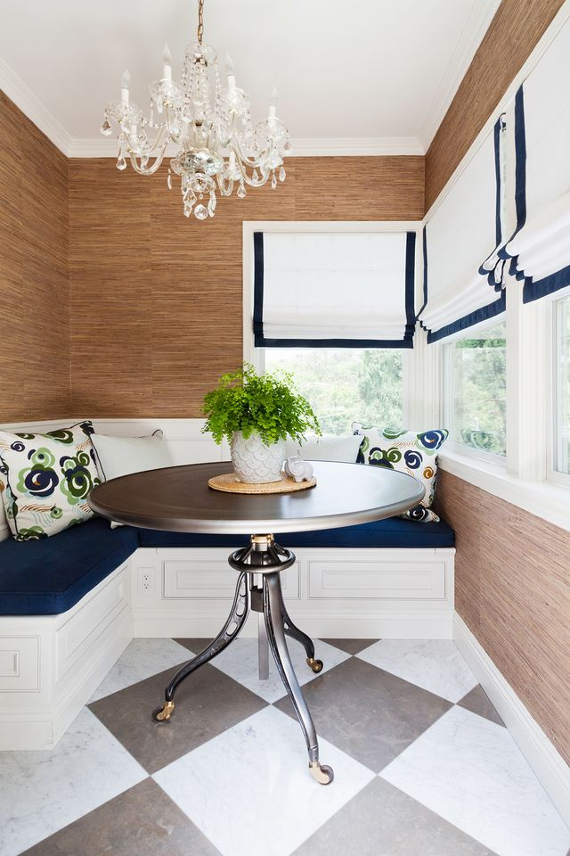 """Throughout the interiors, Jacobson instilled a current of blue, be it a dark denim rug, soft-blue kitchen cabinets, or richly painted built-in bookcases. """"I am always attracted to the color..."""