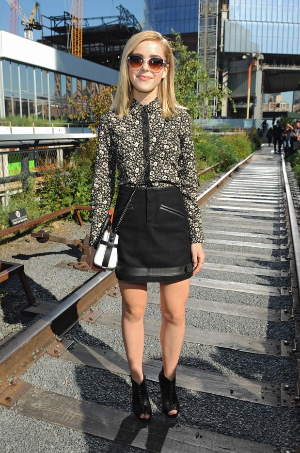 WHO: Kiernan Shipka  WHAT: Coach S/S 16 show  WEAR: Coach top, skirt, Swagger 20 Bag With Chain ($395) in Pebble Leather, and Olie Booties ($275).