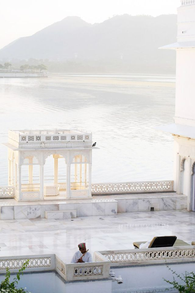 Udaipur, India, is famous for its magnificent palaces—the city's main City Palace is pictured—set along peaceful lakes.  Location: Udaipur, India