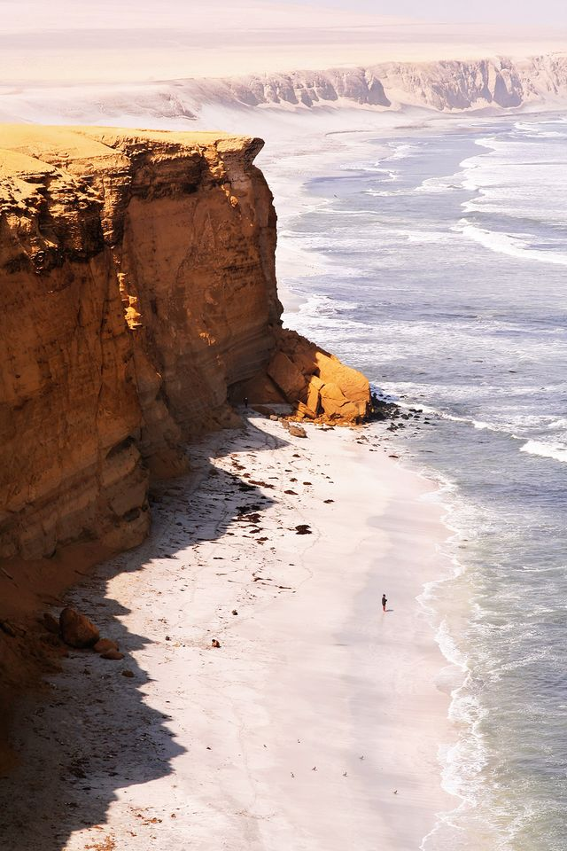 The sheer scale of this photo will catch your breath—see that tiny little person down below? The shot was captured in the Paracas National Reserve in Peru and was pinned by Carla...