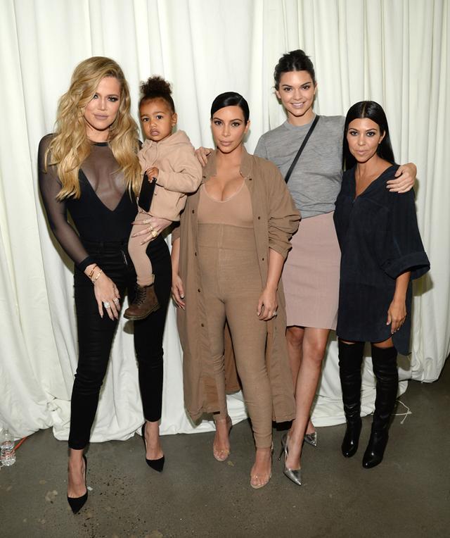 WHO: Khloé Kardashian, North West, Kim Kardashian, Kendall Jenner, and Kourtney Kardashian  WHAT: Backstage at the Kanye West Yeezy Season 2 show  WEAR: On Khloé Kardashian: J...