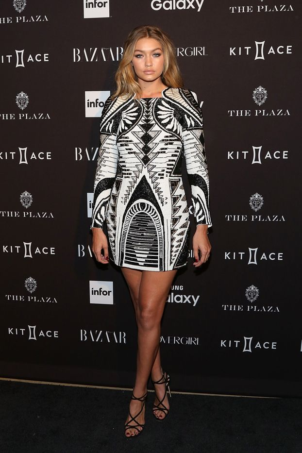 WHO: Gigi Hadid  WHAT: Harper's Bazaar Icons party  WEAR: Balmain x H&M Dress ($649, available November 5).