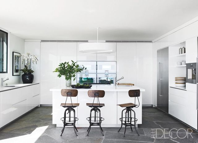 Nothing screams fresh like a completely white kitchen. The gorgeous slate floor anchors this pale pretty, and the vintage industrial bar stools bring a touch of the old in with the...