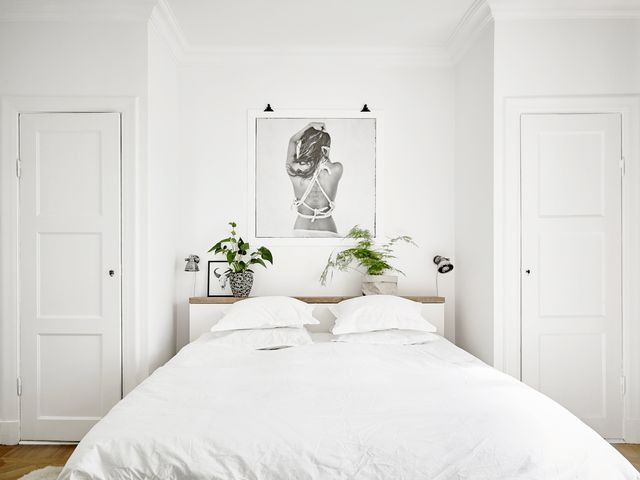 Don't you just want to snuggle up in this cloud-like bed? We do. Why? Because this entire space says nothing else. This dreamy decor in all-white hues just invites sleep.