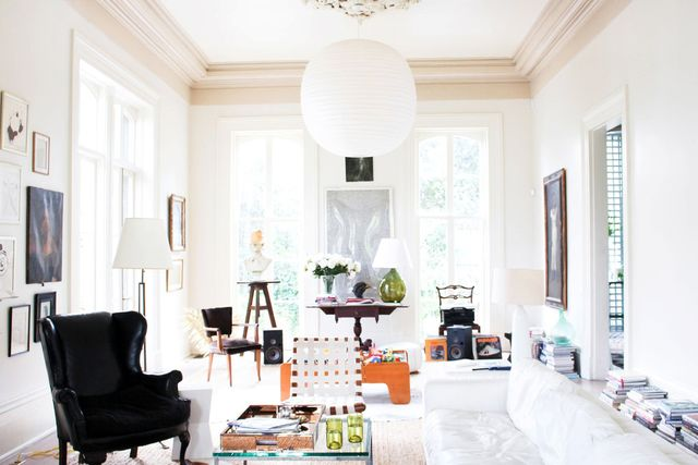 This is a room we all want to dwell in. The eclectic elements against the white add a touch of drama with books lining the walls, a mix of chair styles, and a modern pendant lamp. This...