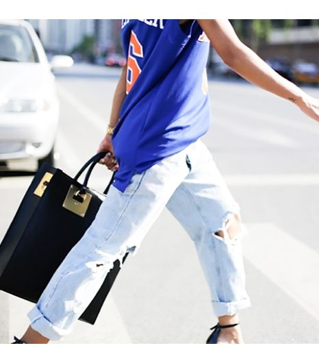 Thehautepursuit is wearing: NBA jersey, Alexander Wang heels, Sophie Hulme bag.