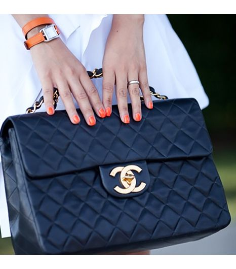 Nininguyen is wearing: Hermes watch, Chanel bag.