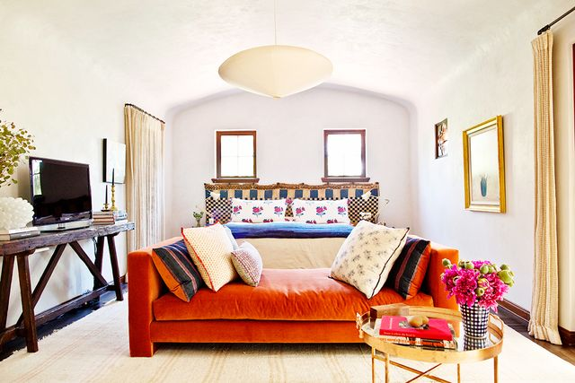 """When it comes to pillows and other textiles, Merrill advises,""""Don't be afraid to mix styles."""" She also champions the classic: """"I love a pile of vintage kilim pillows..."""