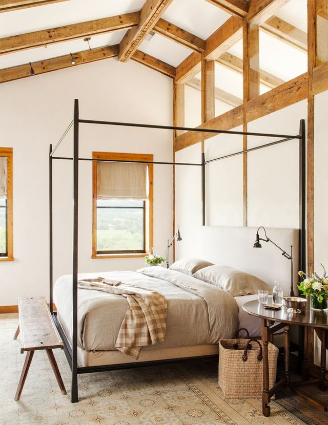A vision of cozy yet airy beauty, this farmhouse-inflected bedroom is the perfect place to let the natural light and surrounding Sonoma landscape wash over you.