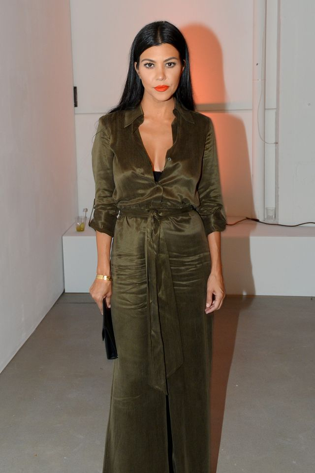 On Kardashian: Alice and Olivia jumpsuit; Céline clutch; Cartier bracelet.
