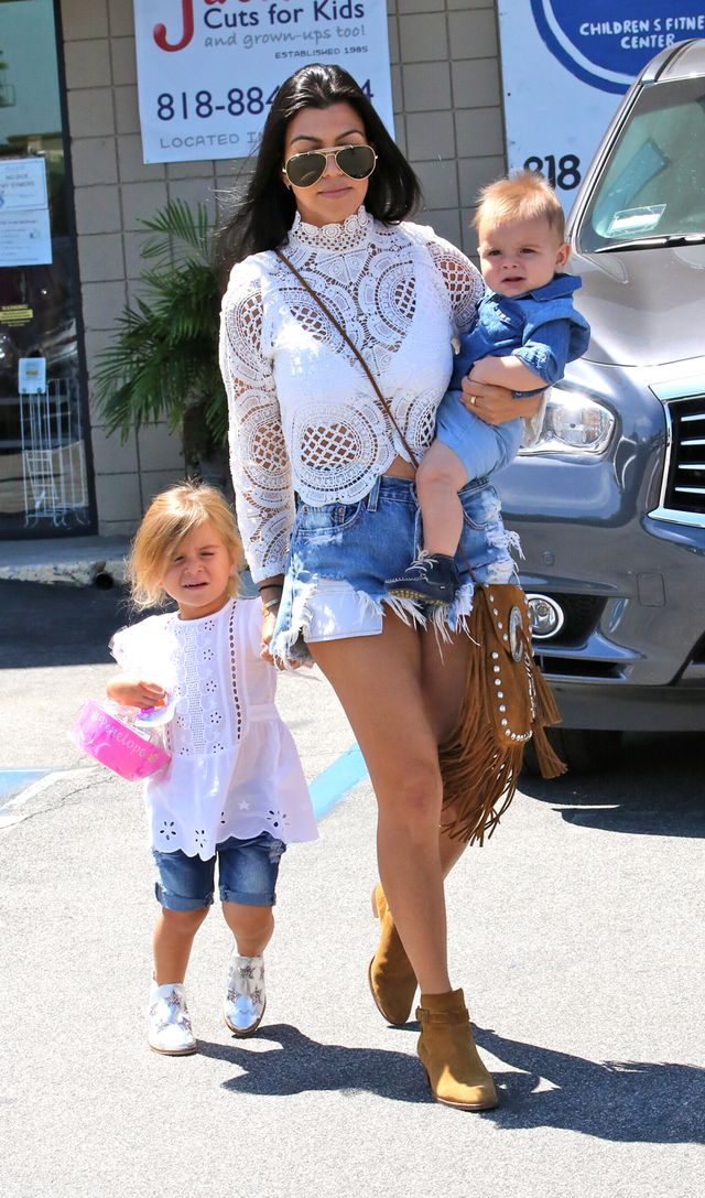 On Kardashian: Asilio top; One Teaspoon shorts; Saint Laurent bag and boots.