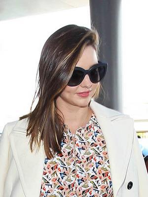 Miranda Kerr Masters the Minidress at the Airport