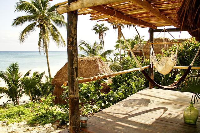 Swinging hammocks look like the perfect place to unwind at the Papaya Playa Project.  Papaya Playa Project |Carretera Tulum-Boca Paila Km. 4.5, Tulum