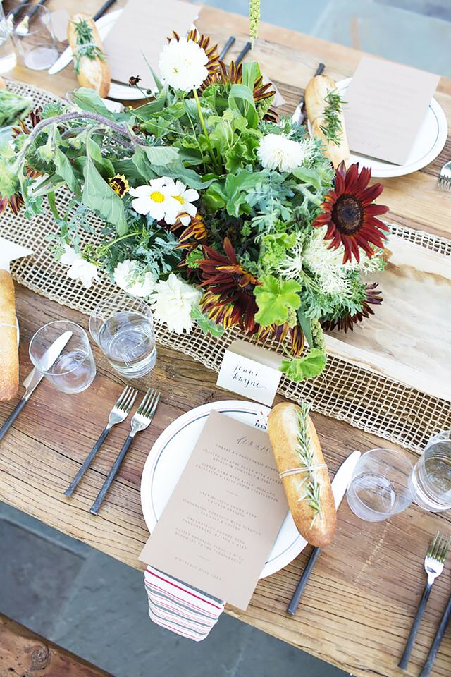 "Completing the scene was an array of gorgeous floral arrangements by Kristen Caissie of Moon Canyon. Inspired by ""the oncoming autumn season and all the florals and fruits that are..."