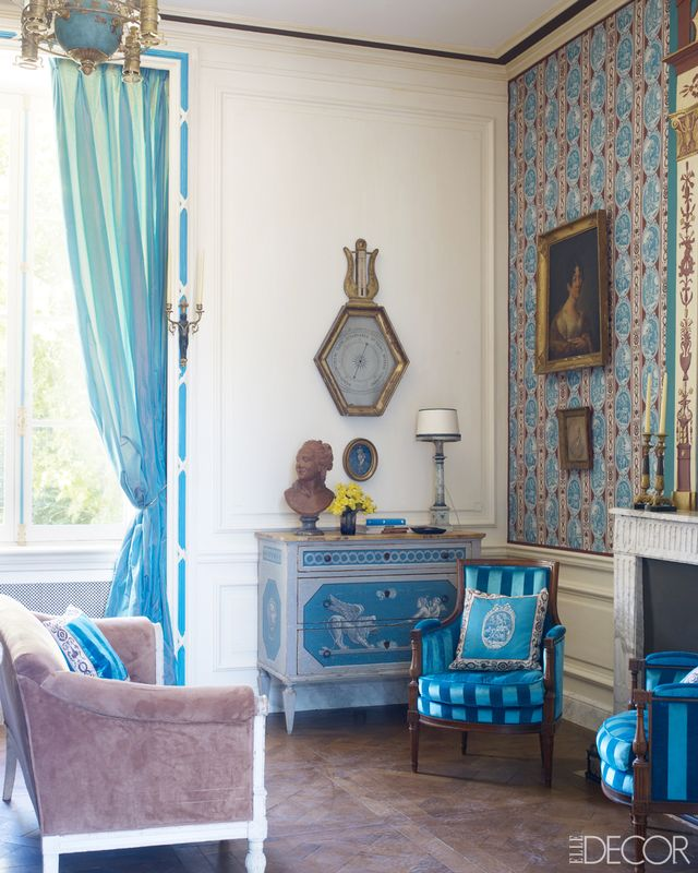 Pattern is an excellent way to evoke the color story and mood of a space. This bright yet traditional print establishes the color story for the entire space, with deep mahogany to bright cerulean...