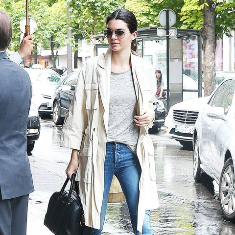 Trench coat + tee + high rise jeans + statement-making ankle boots