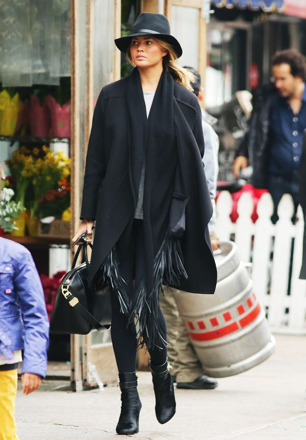Black coat + scarf + leggings + boots + fedora