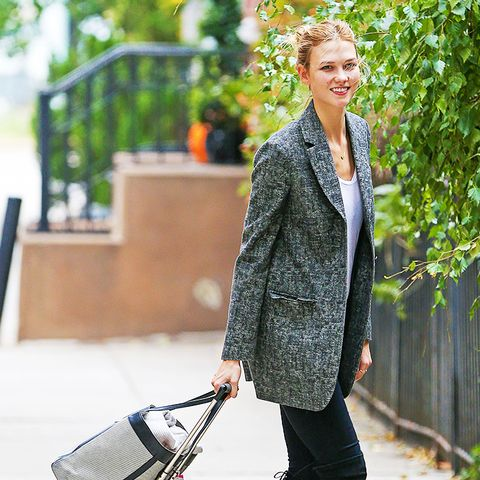 Oversize blazer + tee + black jeans + over-the-knee boots
