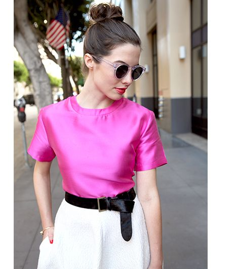 Pink-tinted lucite glasses are a modern and playful touch that keep the outfit from reading overly prim.