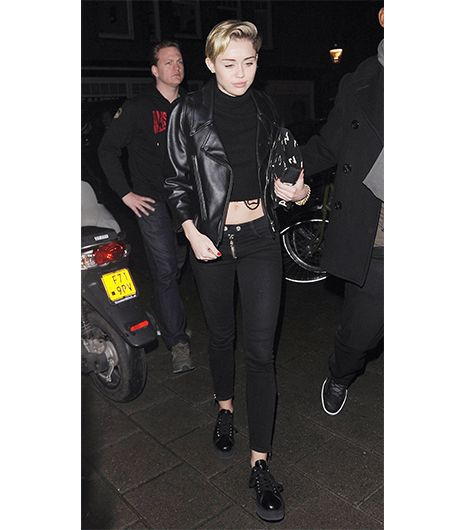 Miley Cyrus  While a crop top paired with a moto jacket seems tame by the pop songstress' standards, we find the look delightfully daring for those willing to show a little midriff. To keep...