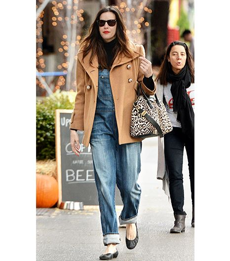 A classic peacoat in this goes-with-anything shade adds polish to roomy overalls.  On Tyler: Givenchy Coat & Antigona Tote ($3,014); Citizens Of Humanity Quincy Overalls; Proenza...