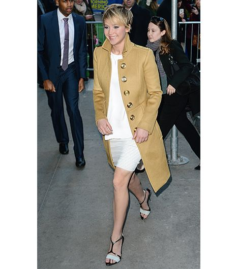 This sharply tailored coat, with its dramatic buttons, is suitable for topping off a minimalist ensemble.  On Lawrence: Burberry Tailored Peplum Coat ($3,595) in Mid Camel; Thakoon...