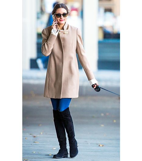 Olivia Palermo manages the proportions of this shorter, funnel-neck style by adding suede knee-high boots. 