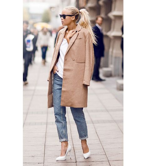 Blogger Victoria Tornegren of I'm Next does the classic cape-as-coat with one fromH&M, draped over a slouchy t-shirt and Topshop Moto Vintage Mom Jeans ($65)...