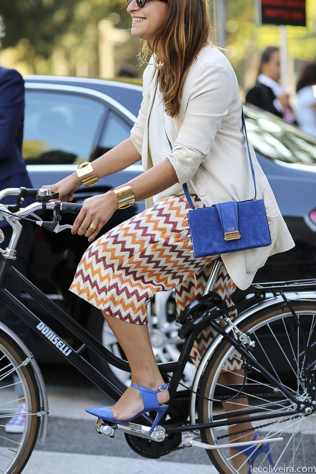 Riding bikes while wearing heels, because, duh, so cute.