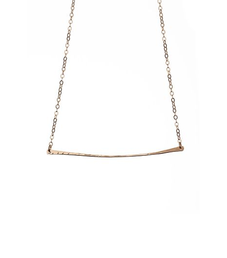 The bohemian babe will fall for the hammered metal on Kenda Kist's necklace.  Kenda Kist Gold Bar Necklace($90)