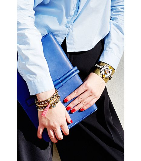 A delightful mix of jewel-encrusted bangles paired with one large statement cuff ensures the look is evening-appropriate.