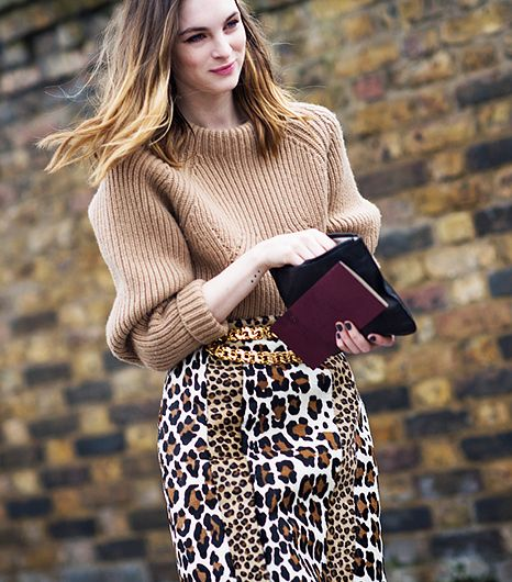 A comfy oversized sweater offsets the inherent drama of a leopard-print pencil skirt and gold belt. 