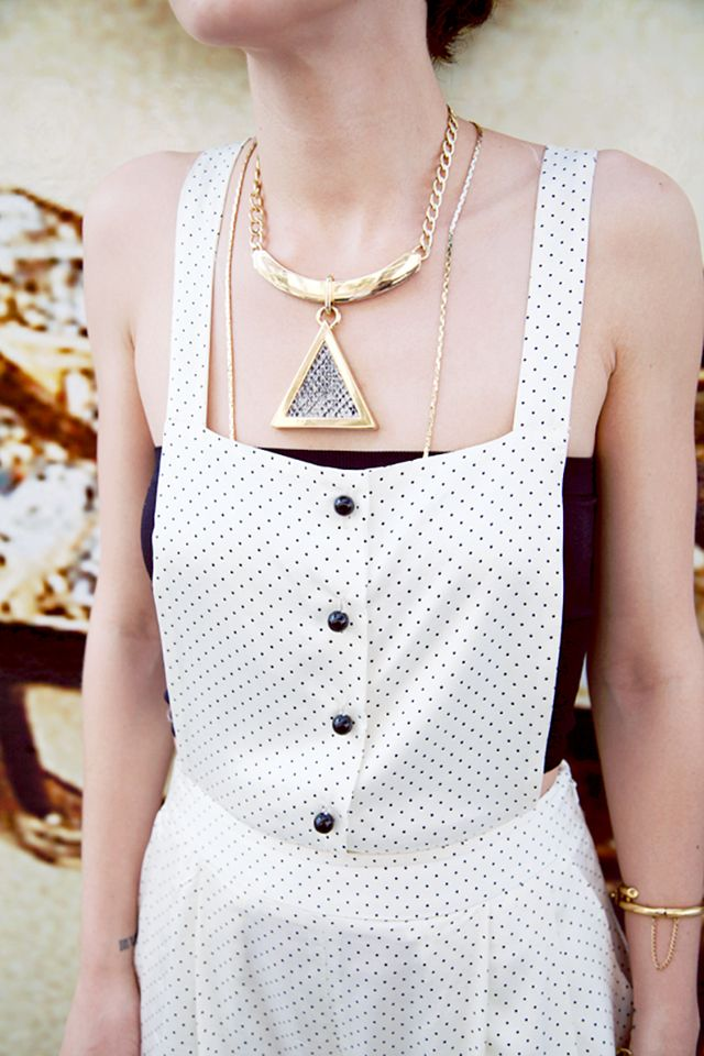 Secret 2: Larger-than-life necklaces pair well with dainty chains.