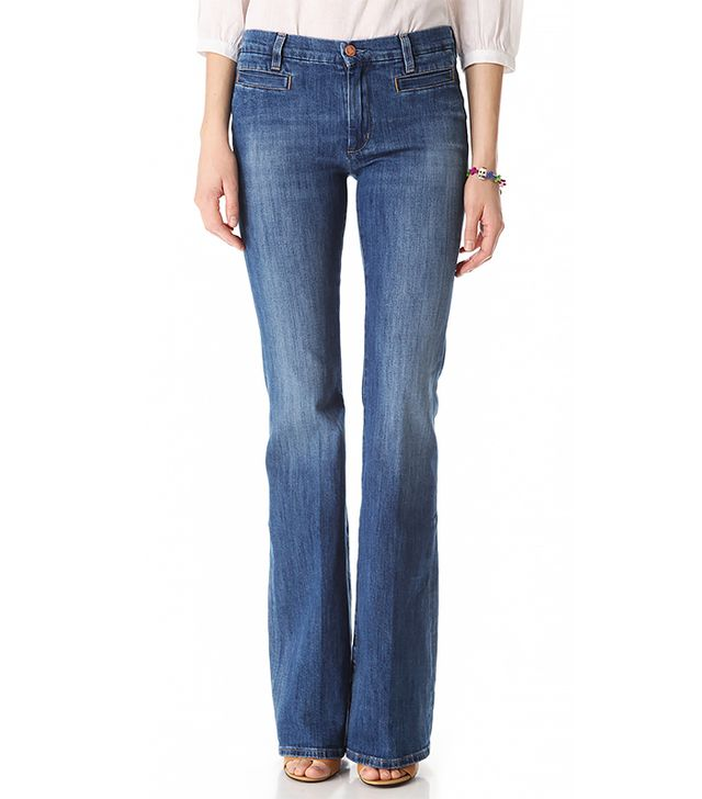 Flare jeans work for your figure in two ways: they draw eyes away from the hips, and the volume at the hem balances out your hips, making them seem perfectly proportioned.