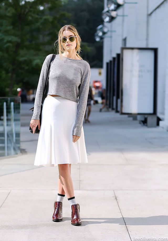 Up your off-duty game by pairing a lightweight sweater with a casual midi skirt and ankle boots for a fuss-free look.