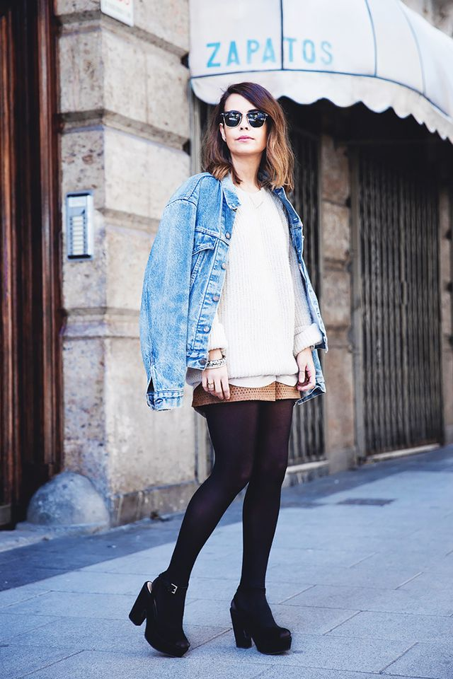 Drape an oversize jean jacket over a neutral sweater, and pair with shorts for a relaxed and stylish outfit.