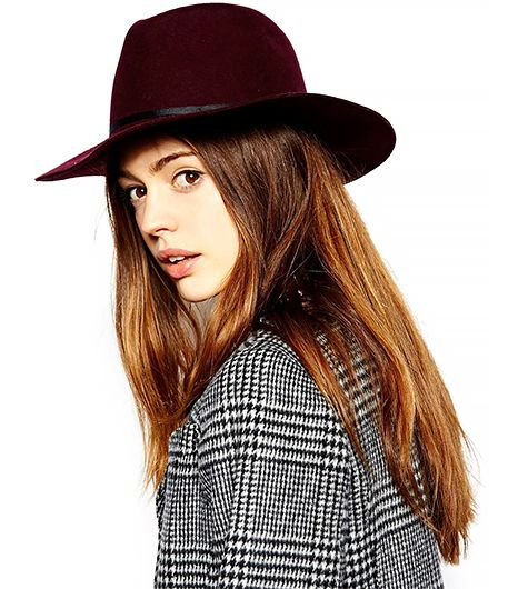 Fedoras are to Coachella as sand is to the beach. This chapeau will add an understated element of color to your outfit.