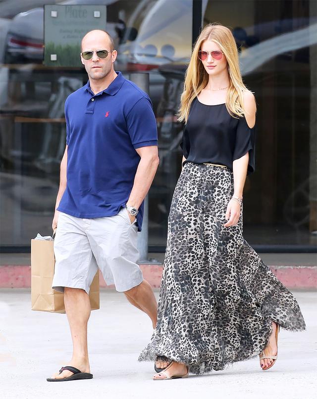 On Huntington-Whiteley: Isabel Marant sunglasses and skirt; Giuseppe Zanotti Metallic Trim Sandals ($576).