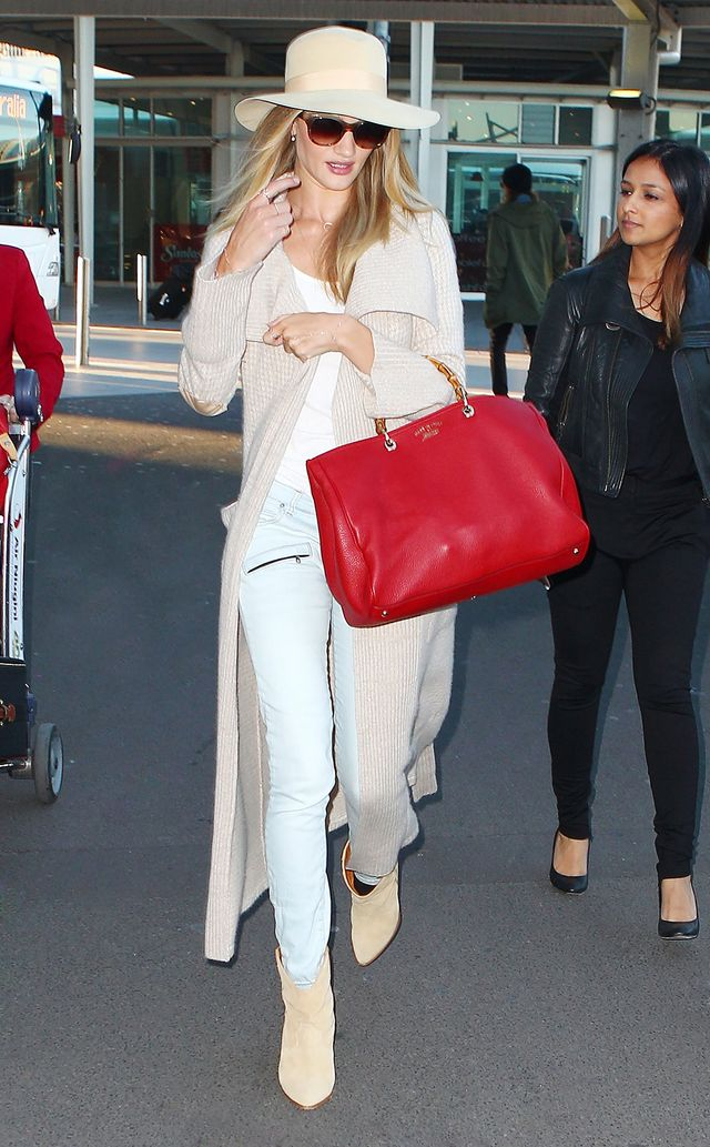 On Huntington-Whiteley: Oliver Peoples sunglasses; Pierre Balmain jeans; Gucci bag; IRO boots.