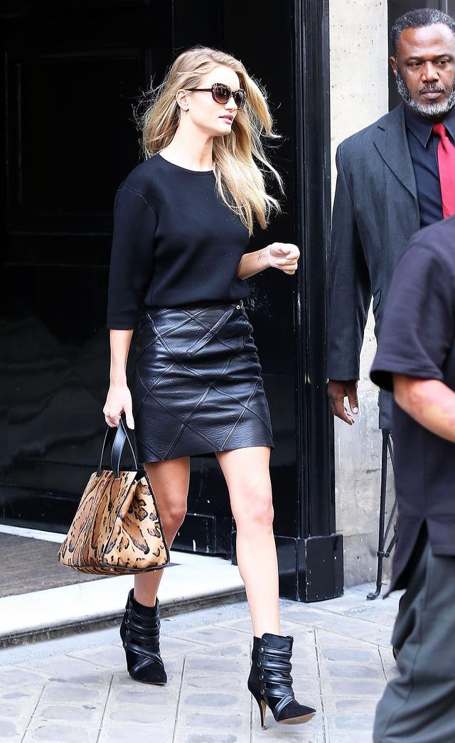 On Huntington-Whiteley: Alexander McQueen sunglasses; J Brand sweater; Loewe x Junya Watanabe skirt; Giorgio Armani bag; Isabel Marant shoes.
